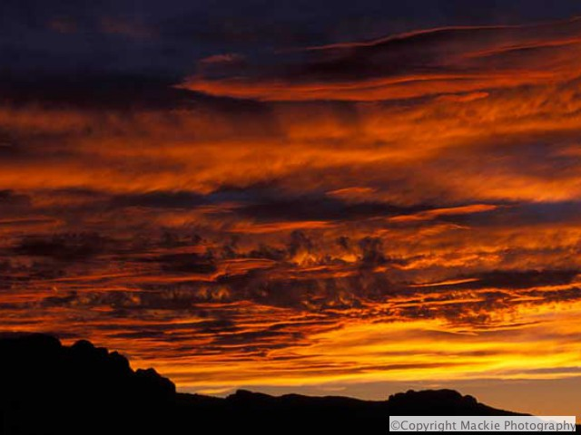 Killer Sunset over silhouette of the Moab rim