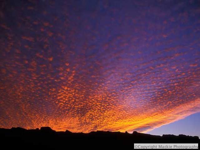 Killer Sunset over silhouette of the Moab rim